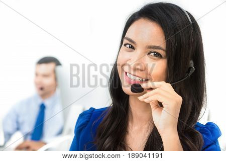 Asian businesswoman working as an operator (or telemarketer) in call center
