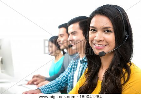 Smiling casual call center (or telemarketer) team