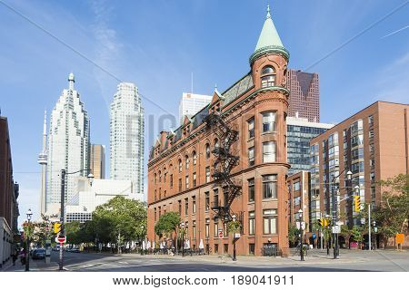 TORONTO,CANADA-AUGUST 2,2015:view of the Gooderham Building (the Flatiron Building) in downtown Torontowith some modern buildings and skyscrapers in the background during a sunny day.