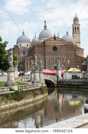 PADUA ITALY - MAY 3 2016: view of Prato della Valle and Basilica of Santa Giustina. Abbey was founded in the fifth century on the tomb of saint Justine of Padua in Padova Italy