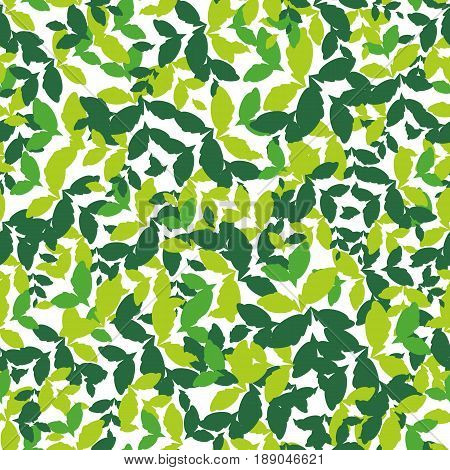 Seamless pattern with green leaves of different shades. Dense rich texture.