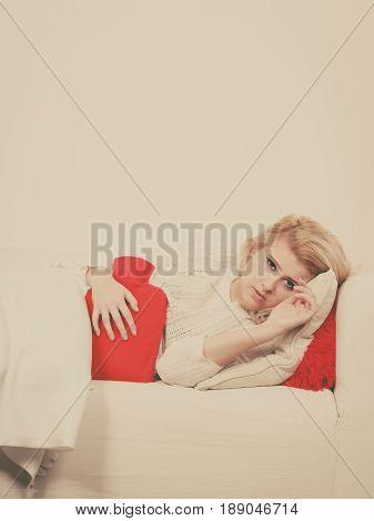 Woman Feeling Stomach Cramps Lying On Cofa