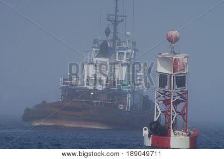 Tug in Morning Fog on Puget Sound, Washington