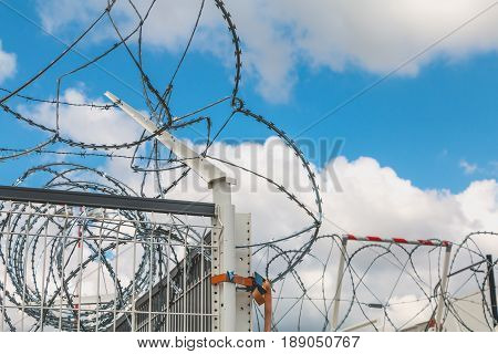 Barbed Wire Razor Blades Type Military On Blue Sky