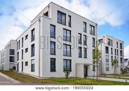 Leonberg, Baden-Wurttemberg, Germany - April 23, 2017: Modern white residential elite low-rise houses with terraces and wide window