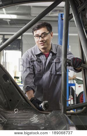 Chinese mechanic working in garage