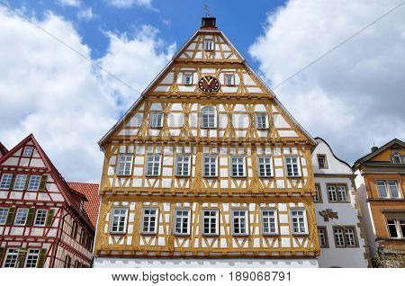 Yellow half-timbered Town Hall on the square of small old town Leonberg, Baden-Wurttemberg, Germany.
