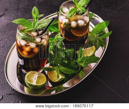 Cuba Libre Cocktail With Cola, Lime, Rum And Peppermint