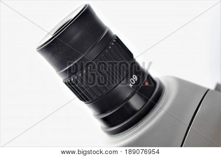 An image of a microscope - lense, zoom