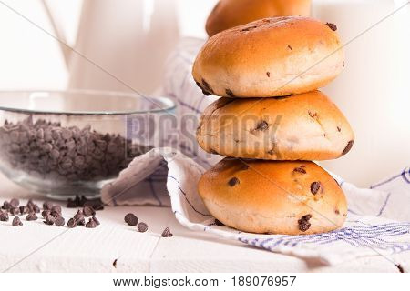 Soft chocolate chip brioche on wooden table.