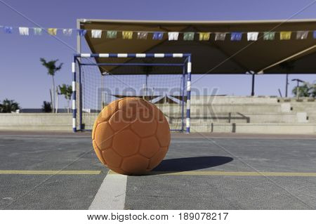 Children's Orange Rubber Soccer Ball Front Of Gates