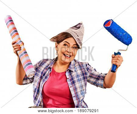 Repair home elderly woman holding paint roller for wallpaper. Happy senior woman in newspaper cap renovation apartment on isolated.