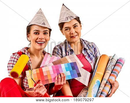 Repair home women holding color guide for wallpaper. Elderly mother and young daughter renovation apartment on isolated.