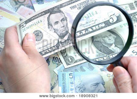 Grabbing Us dollar to check fake money