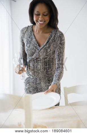 African American woman setting table