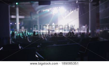 Abstract blurred - a crowd of people at the rock concert in club