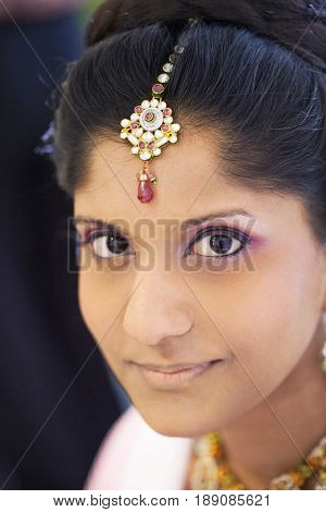 Indian bride wearing head jewelry