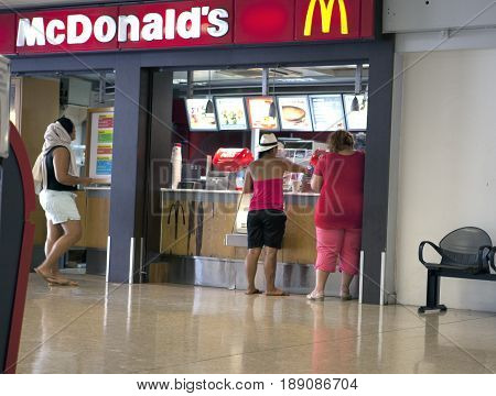 POLINESIA- JUNE 16: people buy food in McDonalds at the airport on june 17 2011 in Polynesia