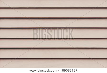 Pastel pink wood planks. Kiln dried wooden lumber texture background. Painted pine furniture surface. Timber hardwood wall.