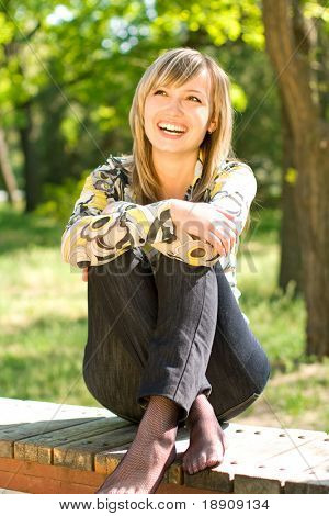 Happy young woman relaxing outdoors