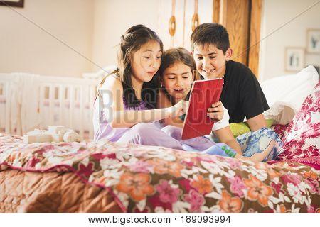 Children using digital tablet together