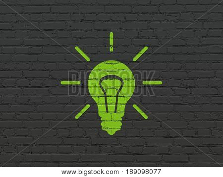 Business concept: Painted green Light Bulb icon on Black Brick wall background