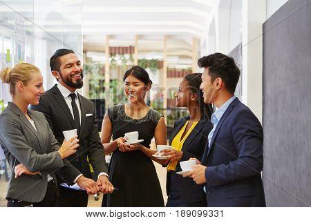 Team making small talk in their coffee break