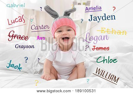 Baby names concept. Cute little child sitting on bed