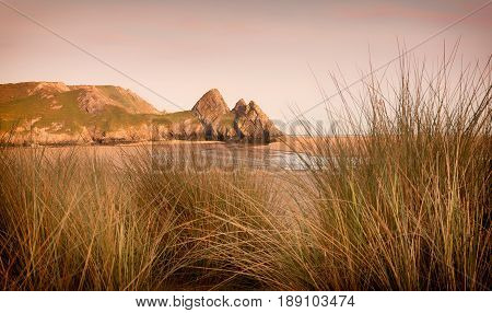Dramatic Three Cliffs Bay on the Gower peninsula, Swansea, South Wales, UK