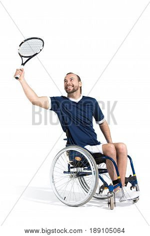 Disabled Young Sportsman In Wheelchair Playing Tennis And Smiling Isolated On White