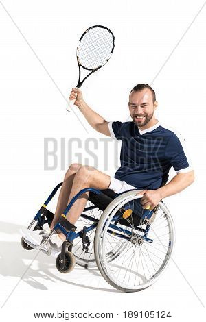 Happy Young Sportsman In Wheelchair Holding Tennis Racquet And Smiling At Camera