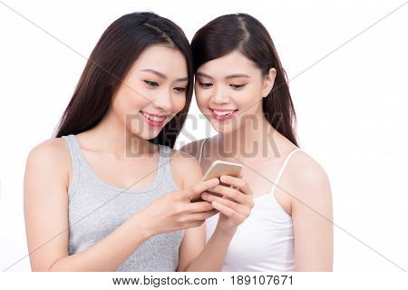 Portrait Of Young Beautiful Asian Woman Laughing With Happiness Face Looking To Smart Phone Use For