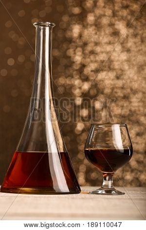 Bottle Of Brown Alcohol Beverage Near Filled Glass