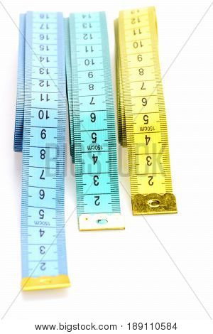 Variety Of Rulers: Blue, Cyan And Yellow Tape Measure