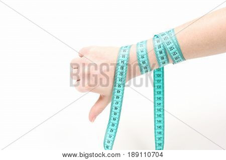 Hand With Thumbs Down And Arm Tied With Measuring Tape