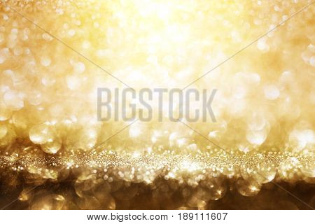 Abstract golden glitter lights background for a solemn occasion