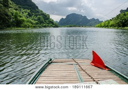 Boat for tourist travel around trang an Vietnam world heritage with mountain river and sky.