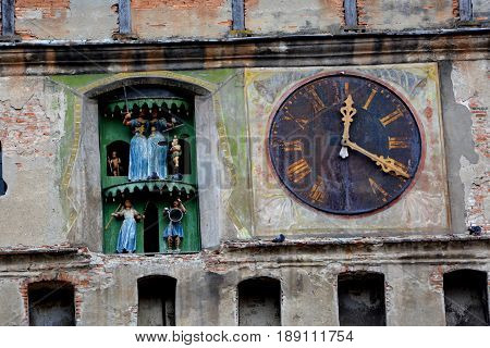 Medieval clock in the main tower. Medieval city Sighisoara. Urban landscape in the downtown of the medieval city Sighisoara, Transylvania