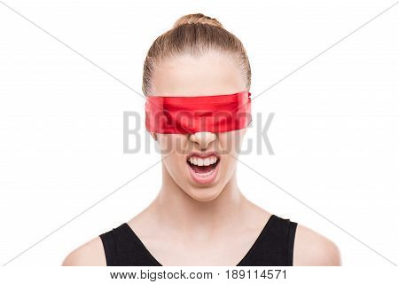 Gymnast In Bodysuit With Eyes Covered With Red Ribbon Showing Disgust Grimace Isolated On White