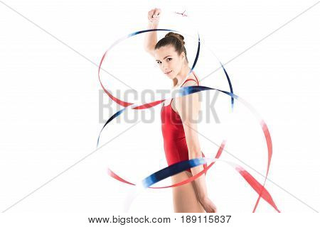 Young Woman Rhythmic Gymnast Exercising With Colorful Rope And Looking At Camera