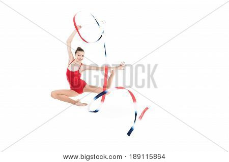 Young Caucasian Woman Rhythmic Gymnast Jumping With Colorful Rope Isolated On White