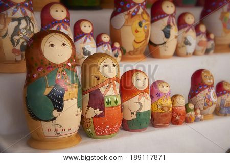 MOSCOW, MAY 26, 2017: Family set Russian dolls matreshka at souvenir market shop Traditional classic Russian culture handicraft art background. Famous classical and modern russian dolls matreshka toys