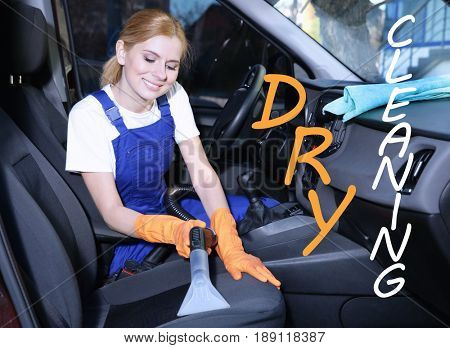 Concept of dry cleaning service. Employee removing dirt from seat in car salon