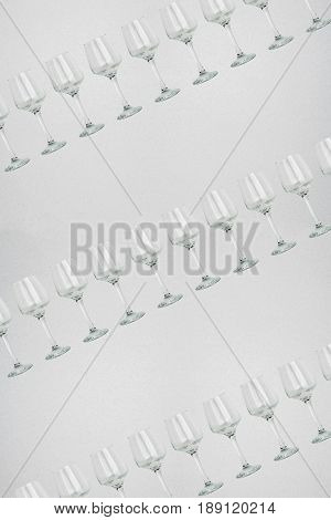 Seamless pattern - glasses over white background. Empty wine glass