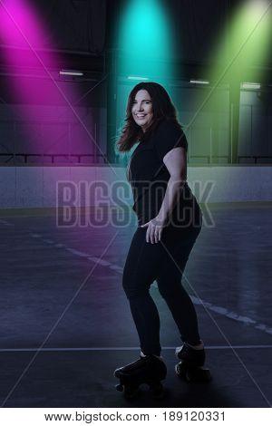 woman having fun at roller skating rink dancing