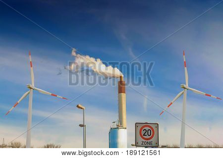 Alternative energy production combined biogas plant and wind power plant.