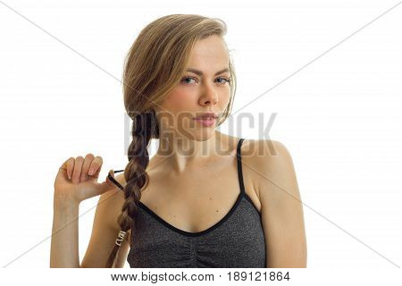 horizontal portrait of sexual blondes with pigtail that keeps the ball away from tulle isolated on white background