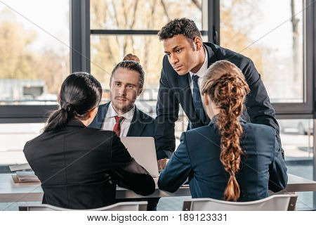 Young Coworkers In Formalwear Arguing At Business Meeting In Office, Business Team Meeting
