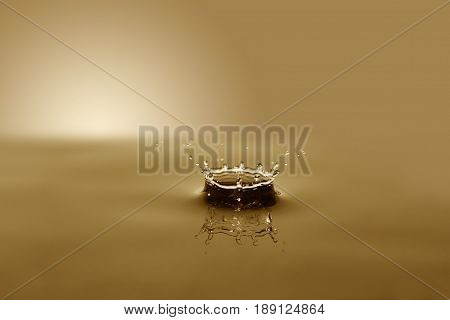 Nice abstract brown water splash on background with free space