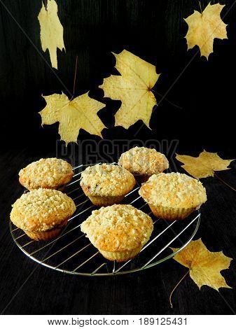 Muffins with streusel and falling leaves in the background